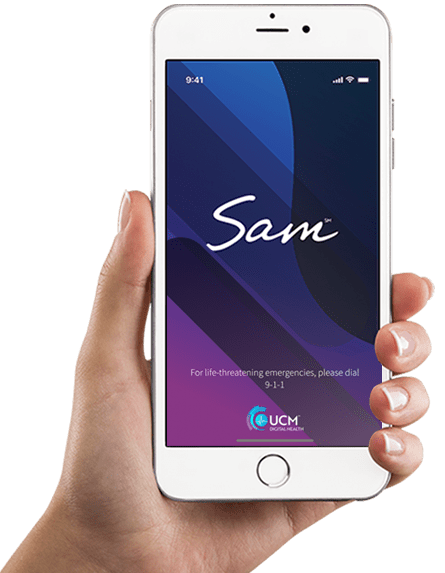 Hand holding phone showing the SAM app